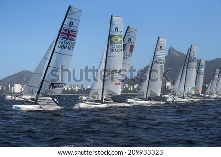 RIO DE JANEIRO,BRAZIL-August 8, 2014:- Warm Rio race- Test to the Rio de Janeiro's Olympig Summer Games . Windsurfers starts for the Warming Rio race on the Guanabara bay preparing the 2016 Oly games.