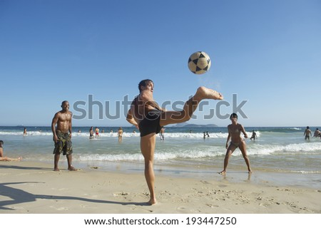 RIO DE JANEIRO, BRAZIL - CIRCA FEBRUARY, 2013: Young Brazilians play keepy uppy altinho football on the shore of Ipanema Beach at Posto 9, a gathering place for the sport.