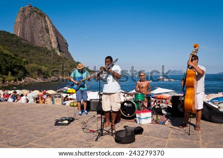 RIO DE JANEIRO, BRAZIL - DECEMBER 28, 2014: Local band perform in front of the Red Beach (Praia Vermelha) on hot and sunny afternoon. - stock photo