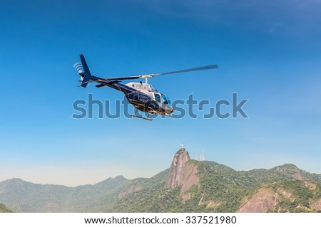 RIO DE JANEIRO, BRAZIL - DECEMBER 21, 2012: The Rio de Janeiro Helicopter Tour in Rio de Janeiro, Brazil. Corcovado and Christ the Redeemer statue is seen in the background. - stock photo