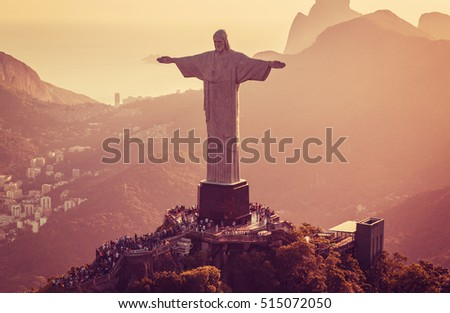 RIO DE JANEIRO, BRAZIL - FEBRUARY 2016: Aerial view of Christ The Redeemer Statue and people visiting Corcovado Hill. Warm afternoon light.