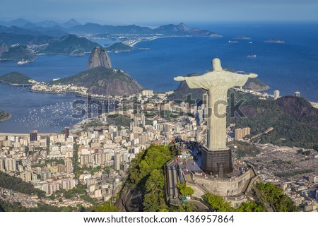 RIO DE JANEIRO, BRAZIL - FEBRUARY 2015: Aerial view of Christ The Reedemer Statue and Sugar Loaf Mountain from high angle. - stock photo