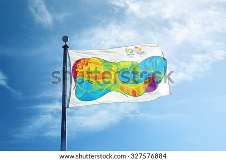 RIO DE JANEIRO, BRAZIL - FEBRUARY 12, 2015: An Olympic flag flutters in the wind against bright blue sky.