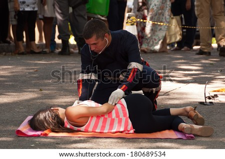 RIO DE JANEIRO, BRAZIL - FEBRUARY 1: Brazilian soap opera episode is being filmed in the street on 1 February 2014. Young woman hit by the bus is getting first medical aid.