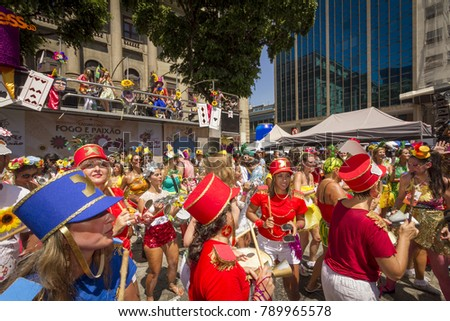 RIO DE JANEIRO, BRAZIL - February 8, 2015: Brazilians celebrate the carnival in the Fire and Passion animation block, in Praça Tiradentes, located in the center of the city of Rio de Janeiro.