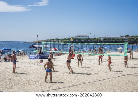 Rio de Janeiro, Brazil February 12, 2015 People playing volleyball on the world famous Copacabana beach - stock photo