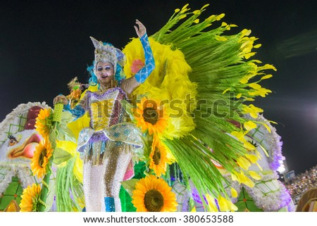RIO DE JANEIRO, Brazil - february 09, 2016: Samba school parade Imperatriz Leopoldinense during the 2016 carnival in Rio de Janeiro, the Sambodromo. People over Float - stock photo