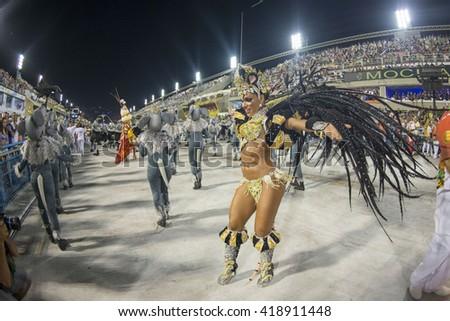 RIO DE JANEIRO, Brazil - february 07, 2016: Samba school parade Padre Miguel during the 2016 carnival in Rio de Janeiro, the Sambodromo. Floor highlight - stock photo