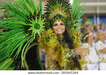 RIO DE JANEIRO, Brazil - february 05, 2016: Samba school parade Rocinha during the 2016 carnival in Rio de Janeiro, the Sambodromo. Floor highlight - stock photo