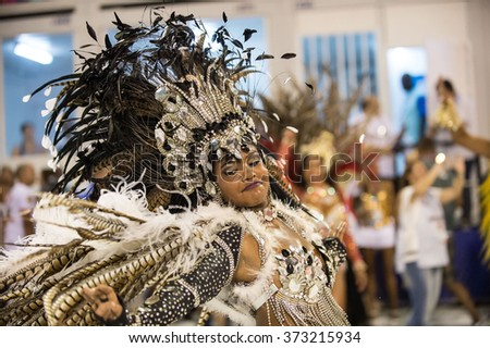 RIO DE JANEIRO, Brazil - february 06, 2016: samba school parade Uniao do Parque Curicica during the 2016 carnival in Rio de Janeiro, the Sambodromo. Dancer performs an evolution - stock photo