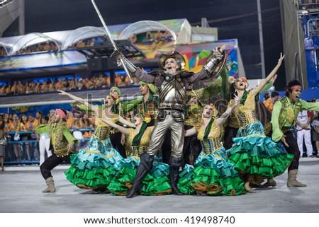 RIO DE JANEIRO, Brazil - february 08, 2016: Samba school parade Unidos de Padre Miguel during the 2016 carnival in Rio de Janeiro, the Sambodromo. Honorary Committee - stock photo