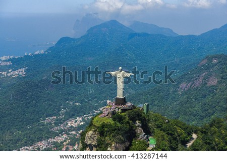 RIO DE JANEIRO, BRAZIL - FEBRUARY, 2016. STATUE OF JESUS CHRIST THE REDEEMER AND CORCOVADO MOUNTAIN