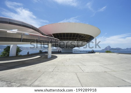 RIO DE JANEIRO, BRAZIL - FEBRUARY 4, 2014: The modernist Niteroi Contemporary Art Museum (MAC) by Oscar Niemeyer features a long curving ramp entrance and wide plaza.