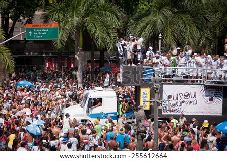 RIO DE JANEIRO, BRAZIL - FEBRUARY 14, 2015: Thousands of revelers in costumes take over the streets of the city center in Rio's largest carnival street bands. Black Ball (Bola Preta)