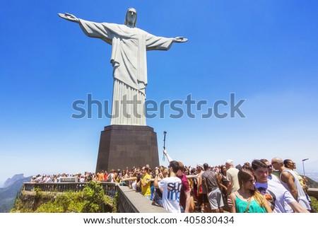 Rio de Janeiro, Brazil - February 9, 2016: Tourists at the Christ the Redeemer statue atop the Corcovado Mountain in Rio de Janeiro, Brazil. - stock photo