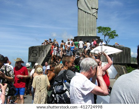Rio de Janeiro, Brazil - February 20: tourists from all around the world making pitures at the statur of Christ the Redeemer in Rio de Janeiro on February 20, 2009 - stock photo