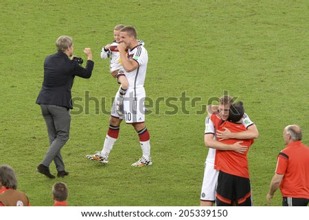 RIO DE JANEIRO, BRAZIL - July 13, 2014: Germany players PODOLSKI,  celebrates after win the match during the 2014 World Cup Final game between Argentina and Germany at Maracana Stadium.  - stock photo
