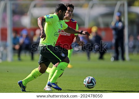 RIO DE JANEIRO, BRAZIL - July 2, 2014: Hulk and Hernanes of the Brazil national football team practicing at Granja Comary training camp in Teresopolis, RJ. NO USE IN BRAZIL.