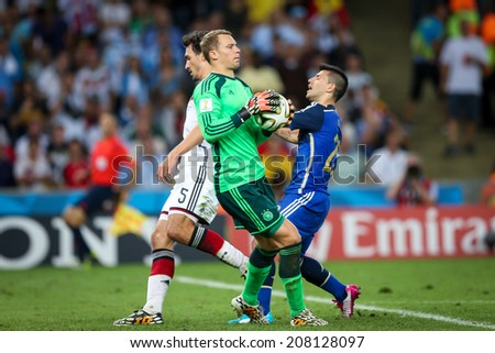RIO DE JANEIRO, BRAZIL - July 13, 2014: Hummels and Neuer of Germany and Aguero of Argentina during the World Cup Final game between Argentina and Germany at Maracana Stadium. NO USE IN BRAZIL.