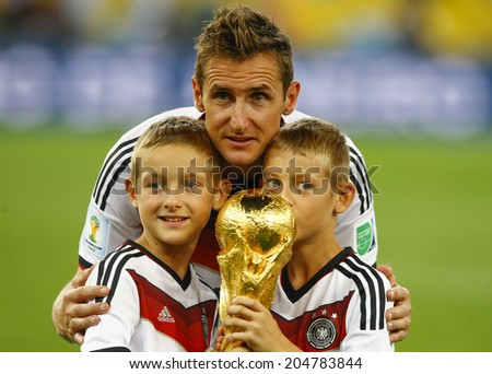 RIO DE JANEIRO, BRAZIL - July 13, 2014: Klose of Germany celebrate with the Trophy winning the 2014 World Cup Final game between Argentina and Germany at Maracana Stadium. NO USE IN BRAZIL. - stock photo