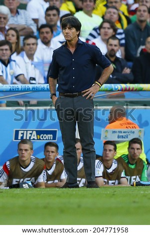 RIO DE JANEIRO, BRAZIL - July 13, 2014: Loew coach of Germany during the 2014 World Cup Final game between Argentina and Germany at Maracana Stadium. NO USE IN BRAZIL.  - stock photo