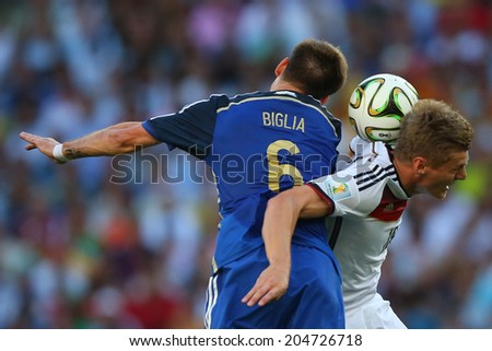 RIO DE JANEIRO, BRAZIL - July 13, 2014: Lucas Biglia of Argentina and Toni Kroos of Germany compete for the ball during the World Cup Final game at Maracana Stadium. NO USE IN BRAZIL.