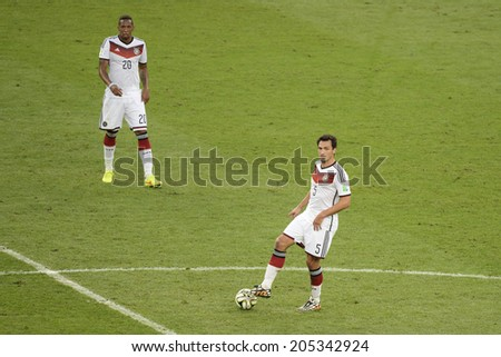 RIO DE JANEIRO, BRAZIL - July 13, 2014: Mats HUMMELS of Germany kicks the ball during the 2014 World Cup Final game between Argentina and Germany at Maracana Stadium.