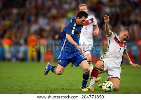 RIO DE JANEIRO, BRAZIL - July 13, 2014: Messi of Argentina and Schweinsteiger of Germany during the 2014 World Cup Final game between Argentina and Germany at Maracana Stadium. NO USE IN BRAZIL.