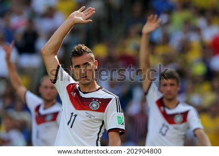 RIO DE JANEIRO, BRAZIL - JULY 04, 2014: Miroslav Klose of Germany celebrates during the World Cup Quarter-finals game between France and Germany in the Estadio Maracana. NO USE IN BRAZIL. - stock photo