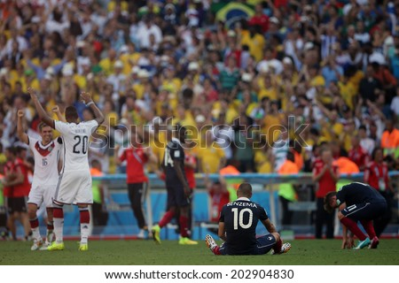 RIO DE JANEIRO, BRAZIL - JULY 04, 2014: Players react at the end of the World Cup Quarter-finals game between France and Germany in the Estadio Maracana. NO USE IN BRAZIL.