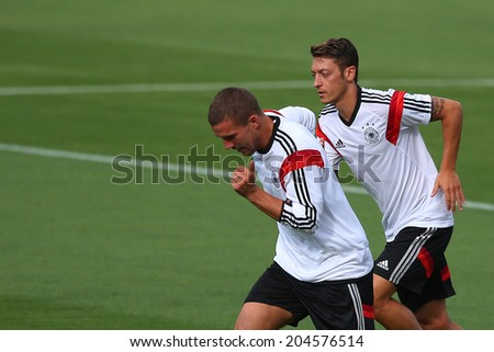 RIO DE JANEIRO, BRAZIL - JULY 12, 2014: Podolski and Oezil of Germany during training session in Sao Januario stadium a day ahead of the World Cup Final. NO USE IN BRAZIL. - stock photo