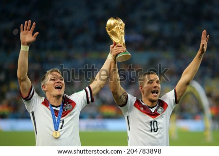 RIO DE JANEIRO, BRAZIL - July 13, 2014: Schweinsteiger and Podolski of Germany celebrate winning the 2014 World Cup Final game between Argentina and Germany at Maracana Stadium. NO USE IN BRAZIL. - stock photo