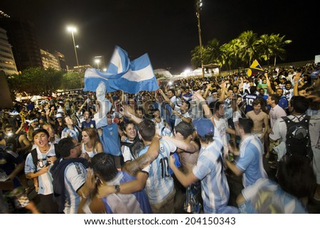 Rio de Janeiro, Brazil - JULY 09, 2014: Soccer fans of Argentina celebrate after the World Cup Semi-finals game between Argentina and the Netherlands at the Fan Fest in the Copacabana beach. NO USE IN BRAZIL.