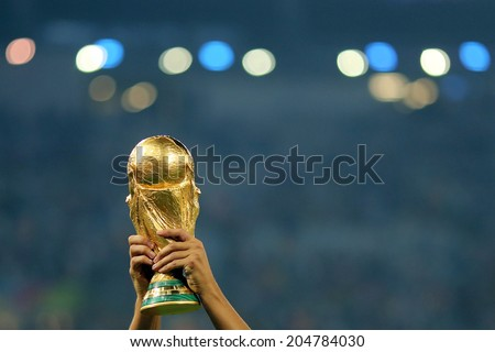 RIO DE JANEIRO, BRAZIL - July 13, 2014: The World Cup Trophy is lifted during the celebrations after the 2014 World Cup Final game between Argentina and Germany at Maracana Stadium. NO USE IN BRAZIL. - stock photo