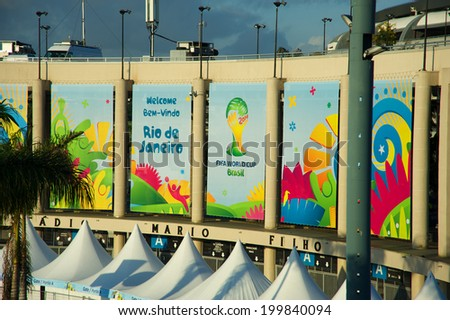 RIO DE JANEIRO, BRAZIL - JUNE 11: Banners outside the Maracana stadium, considered one of the most important landmarks of soccer, one day before the FIFA World Cup started, on June 11, 2014.  - stock photo