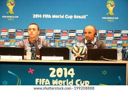RIO DE JANEIRO, BRAZIL - June 17 2014: Chile coach Jorge Sampaoli and player marcelo before the FIFA 2014 World Cup game in the Group F at Maracana Stadium. No Use in Brazil.