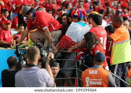 RIO DE JANEIRO, BRAZIL - June 18, 2014: Chile soccer fans invade the stadium through an emergency door before the World Cup Group B game between Spain and Chile at Maracana Stadium. No Use in Brazil.