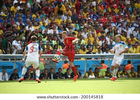 RIO DE JANEIRO, BRAZIL - June 22, 2014: De Bruyne of Belgium kicks the ball during the 2014 World Cup Group H game between Russia and Belgium at Maracana Stadium. No Use in Brazil.