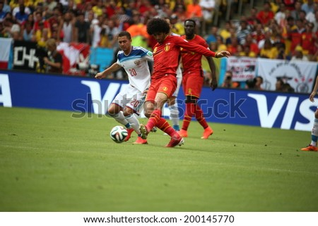 RIO DE JANEIRO, BRAZIL - June 22, 2014: Fellaini of Belgium and Fayzulin of Russia competes for the ball during the 2014 World Cup Group H game between Russia and Belgium at Maracana Stadium. No Use in Brazil.