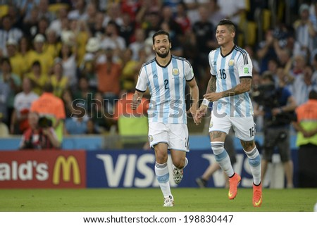 RIO DE JANEIRO, BRAZIL - June 15, 2014: GARAY and Marcos ROJO of Argentina celebrates after scoring a goal during the 2014 World Cup Group F game between Argentina and Bosnia at Maracana Stadium