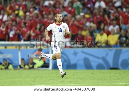 RIO DE JANEIRO, BRAZIL - June 18, 2014: Jorge VALDIVIA of Chile during the FIFA 2014 World Cup. Spain is facing Chile in the Group B at Maracana Stadium - stock photo