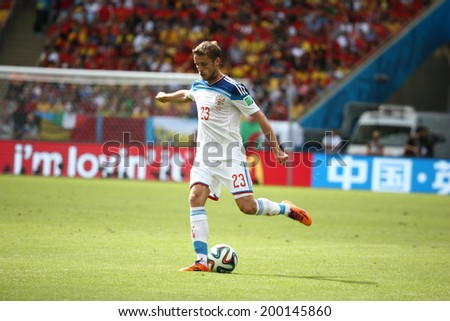 RIO DE JANEIRO, BRAZIL - June 22, 2014: Kombarov of Russia kicks the ball during the 2014 World Cup Group H game between Russia and Belgium at Maracana Stadium. No Use in Brazil.