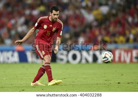 RIO DE JANEIRO, BRAZIL - June 18, 2014: Sergio BUSQUETS of Spain,  during the FIFA 2014 World Cup. Spain is facing Chile in the Group B at Maracana Stadium - stock photo