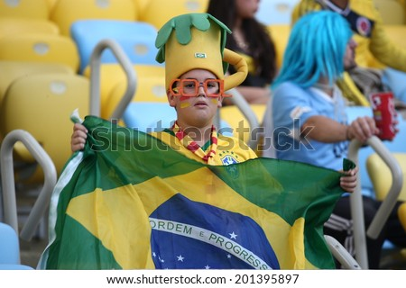 RIO DE JANEIRO, BRAZIL - June 28, 2014: soccer fans celebrating at the 2014 World Cup Round of 16 game between Colombia and Uruguay at Maracana Stadium. No Use in Brazil.