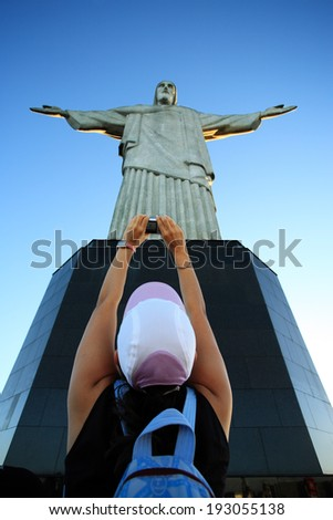 RIO DE JANEIRO, BRAZIL - JUNE 18, 2010: tourist taking a picture of the corcovado christ redeemer - stock photo
