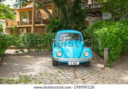 RIO DE JANEIRO, BRAZIL - MARCH 13, 2014: Old blue Volkswagen Type 1 Beetle, parked in Buzios.  - stock photo