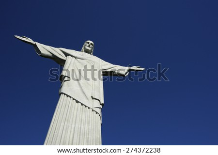 RIO DE JANEIRO, BRAZIL - MARCH 05, 2015: Statue of Christ the Redeemer stands in clear blue sky in bright morning sun. - stock photo