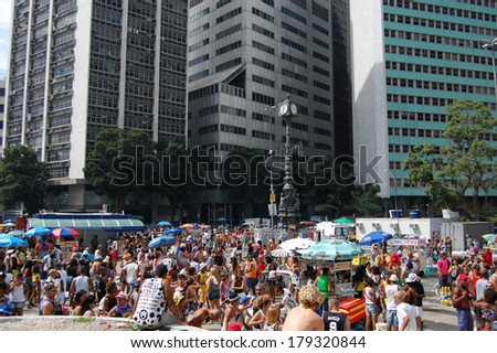 RIO DE JANEIRO, BRAZIL - MARCH 1, 2014: Thousands of revellers in costumes take over the streets of the city centre in Rio's largest carnival street bands. - stock photo