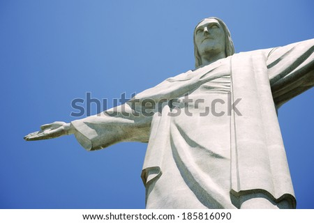 RIO DE JANEIRO, BRAZIL - OCTOBER 20, 2013: Close-up of the statue of Christ the Redeemer at Corcovado Mountain standing against blue sky.