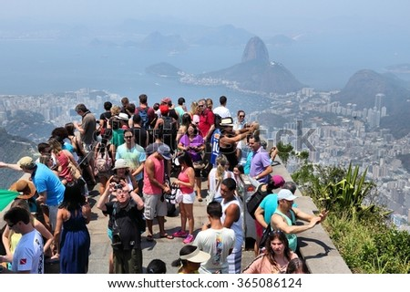 RIO DE JANEIRO, BRAZIL - OCTOBER 19, 2014: Overcrowded scenic overlook next to Christ the Redeemer in Rio de Janeiro. In 2013 1.6 million international tourists visited Rio. - stock photo